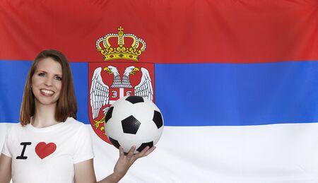 female soccer: Serbia Flag with female soccer fan