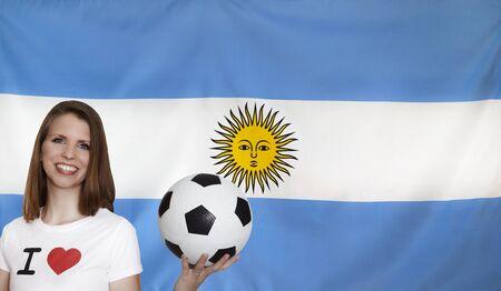 female soccer: Argentina Flag with female soccer fan