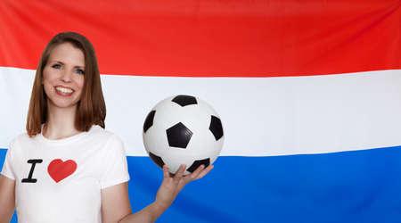 female soccer: Netherlands Flag with female soccer fan Stock Photo