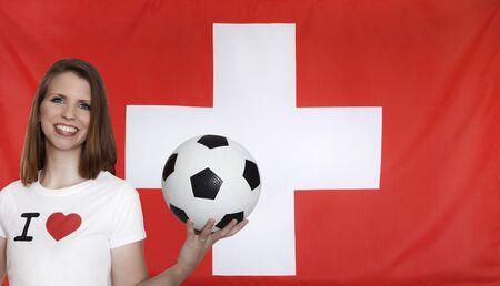 female soccer: Switzerland Flag with female soccer fan Stock Photo