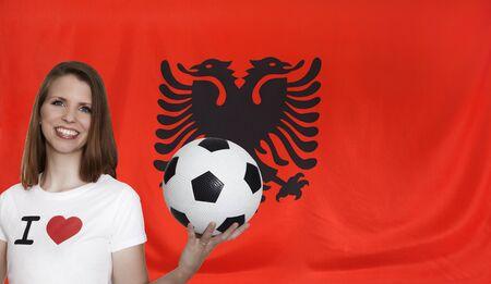 female soccer: Albania Flag with female soccer fan