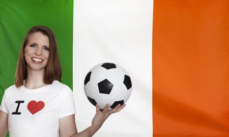 female soccer: Republic of Ireland Flag with female soccer fan Stock Photo