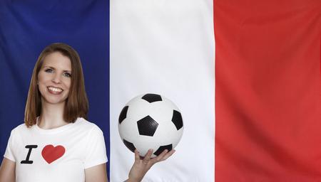 female soccer: France Flag with female soccer fan Stock Photo