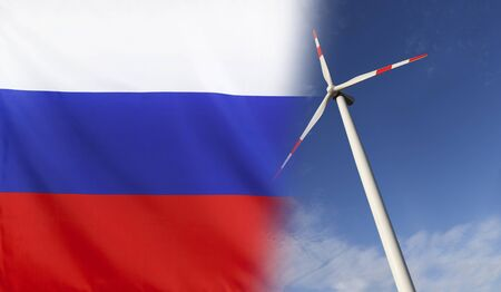merged: Concept clean energy with flag of Russia merged with wind turbine in a blue sunny sky