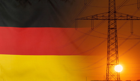 Concept Energy Distribution, Flag of Germany with high voltage power pole during sunset