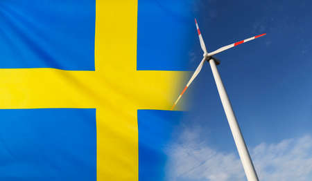 Concept clean energy with flag of Sweden merged with wind turbine in a blue sunny sky Stock Photo