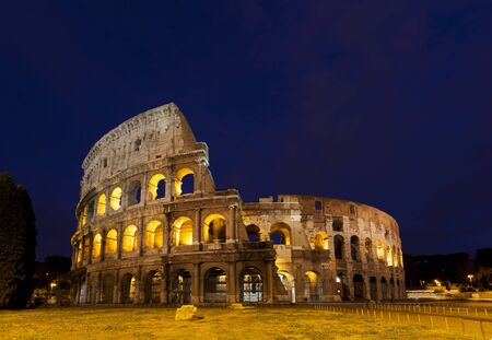 Colosseum Amphitheater in Rome, Italy during twilight and sunset. Stock Photo