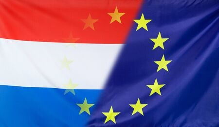 diagonally: Netherlands and European Union relations concept with diagonally merged real fabric flags