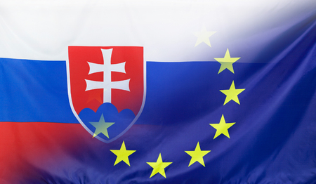 diagonally: Slovakia and European Union relations concept with diagonally merged real fabric flags Stock Photo