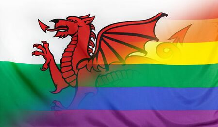 LGBT movement concept with fabric rainbow flag merged with real textile flag of Wales