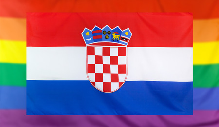 LGBT movement concept with real textile flag of Croatia placed within a blurred rainbow flag background