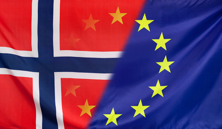 merged: Norway and European Union relations concept with diagonally merged real fabric flags Stock Photo