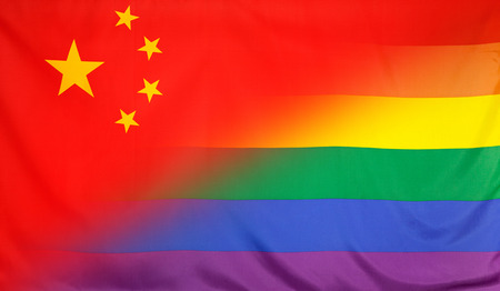 LGBT movement concept with fabric rainbow flag merged with real textile flag of China