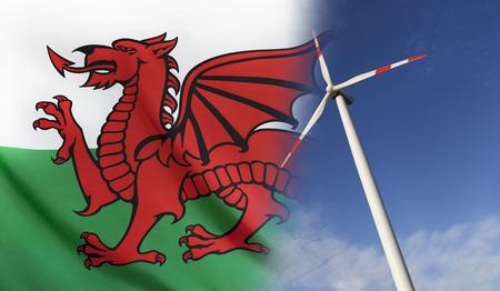 L'energia pulita del concetto con la bandiera del Galles si è fusa con la turbina di vento in un cielo soleggiato blu