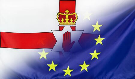northern ireland: Northern Ireland and European Union relations concept with diagonally merged real fabric flags
