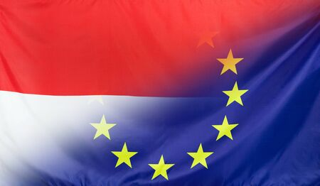 Indonesia and European Union relations concept with diagonally merged real fabric flags
