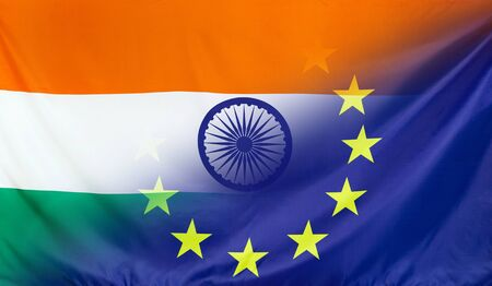 India and European Union relations concept with diagonally merged real fabric flags