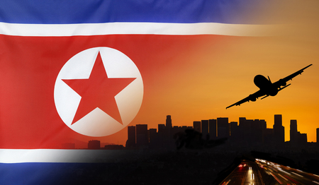 Travel and transport concept with skyline silhouette, highway traffic and airplane at sunset merged with real fabric flag of North Korea