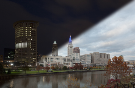 Cleveland skyline downtown night waterfront skyscrapers with reflections