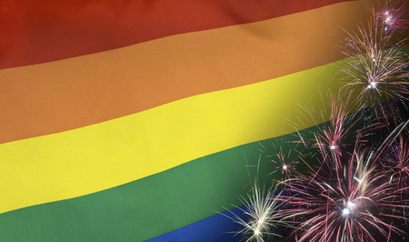 Textile Rainbow Flag with firework seamless close up with wind waves in the real fabric  Stock Photo