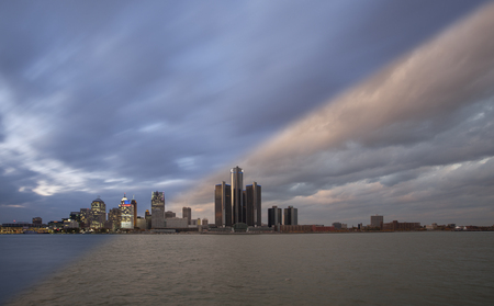Detroit city waterfront and skyline sunset and twilight transition with clouds passing by