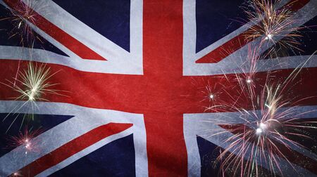 Textile flag of United Kingdom with firework grunge concept seamless close up with wind waves in the real fabric Standard-Bild