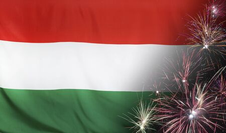 Textile flag of Hungary with firework seamless close up with wind waves in the real fabric  Stock Photo