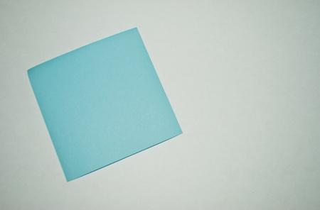 postit blue on white paper