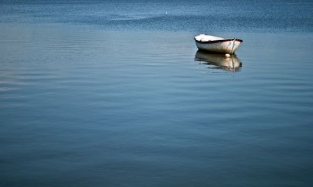 float: only boat on the lake puccini Stock Photo