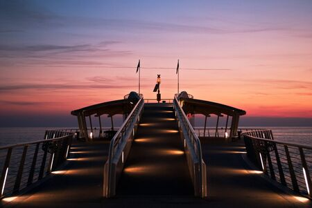 lido di camaiore jetty at sunset Stock Photo