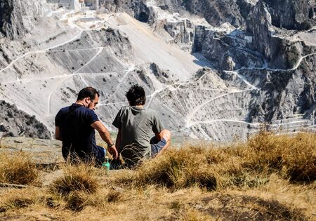 two guys talking in the mountains