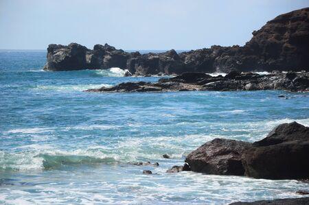 cliff in rough sea