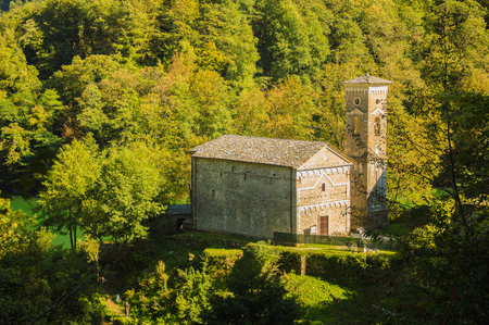 Church bell tower with hidden between the Apuan Alps Stock Photo