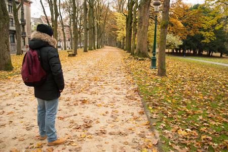 boy walking in a park in autumn