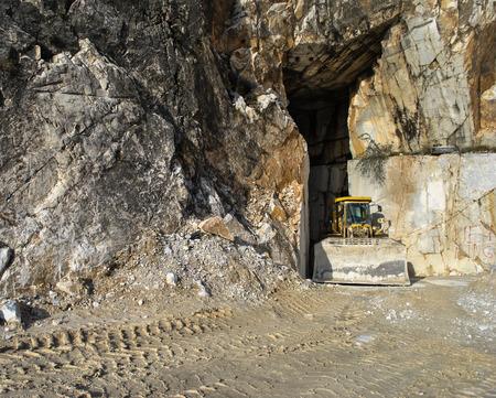 marble quarry in Carrara with bulldozer