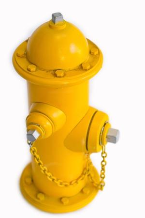 borne fontaine: Bouche d'incendie miniature dans la couleur jaune close-up