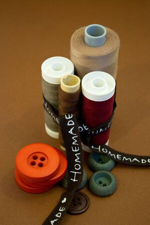 Sewing thread and buttons in vaus colors and ribbon Stock Photo - 13803494