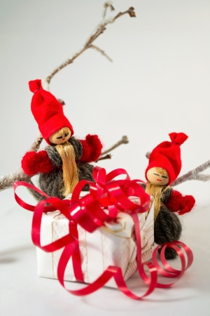 Old-fashioned Santa Clauses with Christmas gift photo