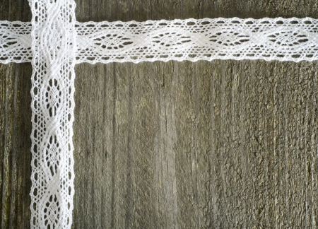 crochet: White lace on the wooden gray background, rustic Stock Photo