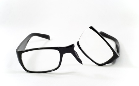 A pair of broken eyeglasses photo
