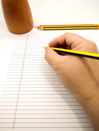 essays: Writing with Pencil on a piece of Blank Paper