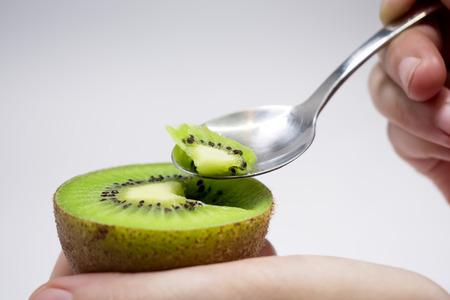 Spooning A Freshly Sliced Kiwi for Dessert