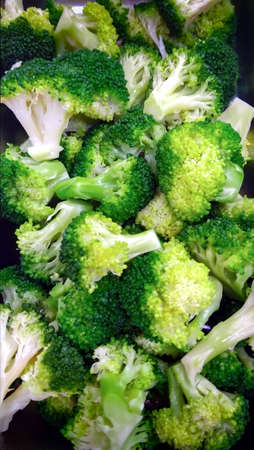 healthful: Pile of Freshly Boiled Broccolli Served at a Salad Bar Stock Photo