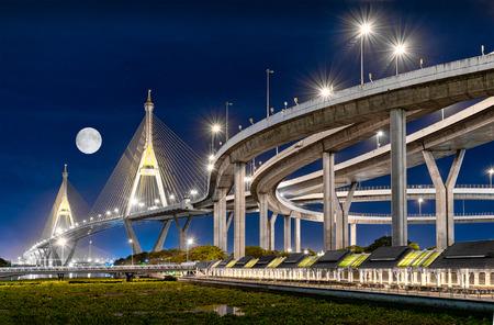 BANGKOK, THAILAND - JUNE 05: Interchange to Industrial Ring Road suspension bridge in the evening