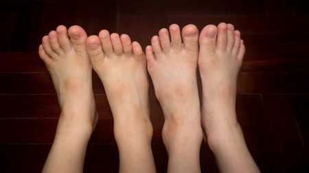 Healthy Siblings Bare Feet Side-by-Side