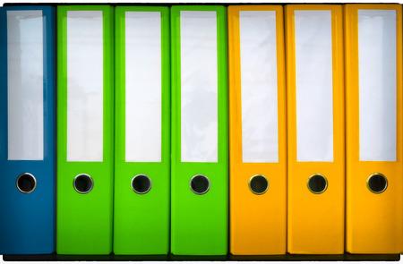 Blauwe, Groene en Gele Bindmiddelen In Een Rij Stockfoto