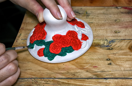 Unpainted Plaster with Flower Pattern being painted