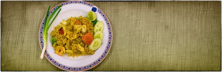 A Dish of Stir Fried Rice with Curry, Squid and Shrimp Banco de Imagens