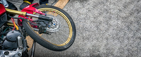 Bent Spoked Wheels on a Damaged Light Weight Motorcycle in an Traffic Accident
