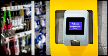A Barcode Price Scanner Installed on the wall for Customers Convenience in a Store